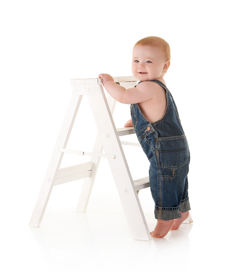 standing-by-ladder-in-overalls